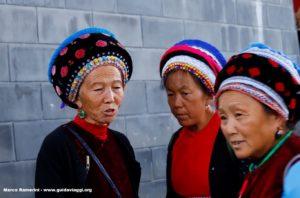 Mujeres, Zhoucheng, Yunnan, China. Autor y Copyright Marco Ramerini...